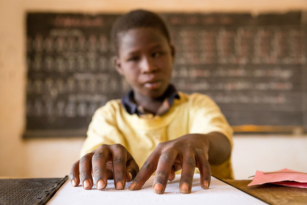 Abdul Aziz Mounkeila learns to read Braille at Ecole Yantala 2, one of 26 schools nationwide that offer integrated classrooms to the deaf and blind.